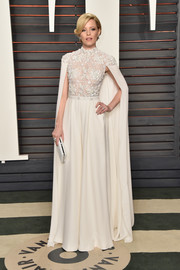 Elizabeth Banks made a head-turning entrance at the Vanity Fair Oscar party in a caped white palazzo jumpsuit by Ralph & Russo Couture.