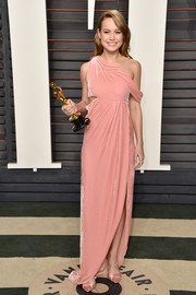 Brie Larson rocked a distressed-chic pink gown by Monse, featuring a side cutout and an off-one-shoulder design, at the Vanity Fair Oscar party.