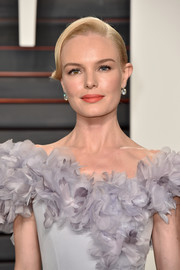 Kate Bosworth's orange lipstick worked beautifully with her lilac dress.