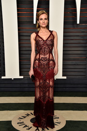 Diane Kruger's red Reem Acra gown at the Vanity Fair Oscar party had plenty going on, from the sheer fabric to the intricate beading to the fringe detailing.