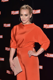 Hilary Duff styled her bright outfit with a simple nude leather clutch for the Viacom Kids and Family Group Upfront.