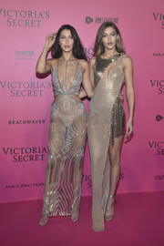 Gigi Hadid looked spellbinding in a metallic high-low cutout gown by Versace at the Victoria's Secret fashion show after-party.