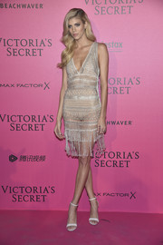 Devon Windsor kept her styling minimal with a pair of white ankle-strap sandals.