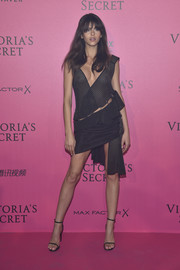 Georgia Fowler hit the Victoria's Secret after-party looking racy in an asymmetrical, see-through mesh dress by Anthony Vaccarello.