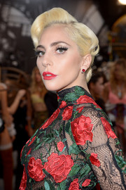 Lady Gaga added an extra pop of red with a pair of ruby studs by Cartier.