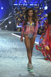 Jasmine Tookes looked relatively conservative in a long-sleeve corset top at the Victoria's Secret fashion show.