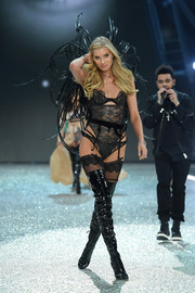 Black latex thigh-high boots rounded out Elsa Hosk's alluring ensemble.