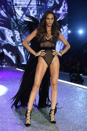 Sexy black lace-up pumps completed Joan Smalls' look.