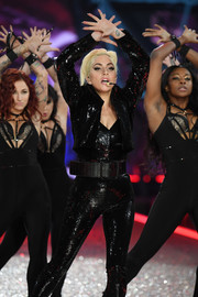 Lady Gaga wore a sequined jacket over a matching jumpsuit for her Victoria's Secret fashion show performance.