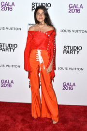 Leandra Medine was bold with her color choices, pairing her red top with orange wide-leg pants.