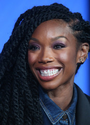 Brandy donned a long braided hairstyle while attending the Winter TCA Tour.
