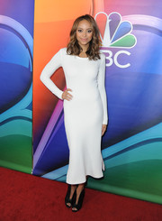 Amber Stevens West was classic and chic in a figure-hugging, long-sleeve LWD at the NBCUniversal Press Tour.