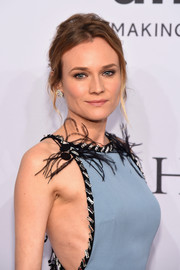 Diane Kruger swept her hair up into a messy 'do for the amfAR New York Gala.