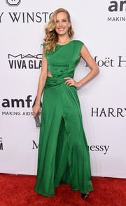 Petra Nemcova chose a green Vionnet gown with a side cutout and a high front slit for the amfAR New York Gala.