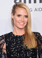 Heidi Klum sported a sleek-straight half-pinned hairstyle at the amfAR New York Gala.