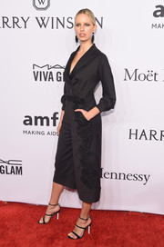 Karolina Kurkova complemented her jumpsuit with strappy black heels by Sophia Webster.