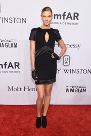 Karlie Kloss was edgy-sexy at the amfAR New York Gala in a black Chanel mini dress with peekaboo detailing.