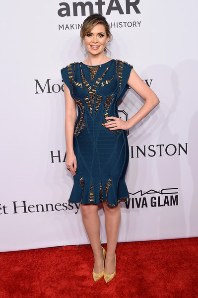 Carly Steel's gold Stuart Weitzman pumps and blue dress made a nice color combo.