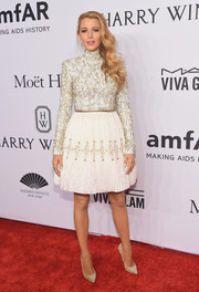 Blake Lively got all glammed up in a heavily beaded cocktail dress by Chanel Couture for the amfAR New York Gala.
