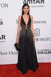 Giovanna Battaglia went for modern glamour at the amfAR New York Gala in a deep-V black Carolina Herrera gown with geometric illusion cutouts.