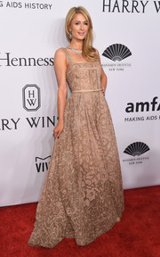 Paris Hilton looked like a princess in this beaded nude gown during the amfAR New York Gala.