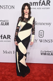 Coco Rocha opted for a modern black-and-white lace-panel gown by Fausto Puglisi for her amfAR New York Gala look.