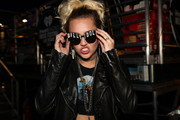 Miley Cyrus was in fangirl mode with these 'Billy Idol' shades at the 2016 iHeartRadio Music Festival.