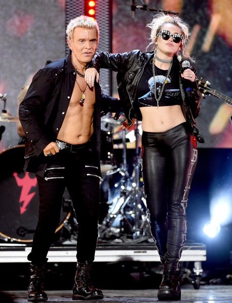 A pair of lace-up platform boots rounded out Miley Cyrus' ensemble.