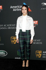 Olivia Cooke kept it relaxed in a white tie-neck shirt by Burberry at the 2017 AMD British Academy Britannia Awards.