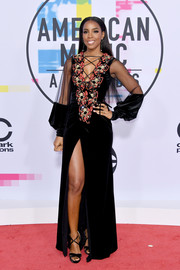 Kelly Rowland was boho-glam at the 2017 American Music Awards in a Galia Lahav Couture velvet gown with an embroidered bodice, a lace-up neckline, and sheer blouson sleeves.