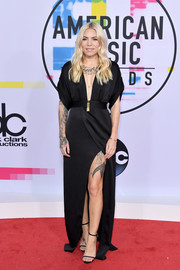 Skylar Grey was all about sexy elegance in a black Halston gown with a plunging neckline and a high slit at the 2017 American Music Awards.
