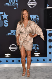 Garcelle Beauvais went for a leggy look in this short, beaded wrap dress at the 2017 BET Awards.