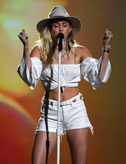 Miley Cyrus topped off her ensemble with a gray walker hat.