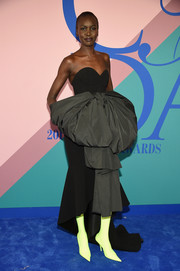 Alek Wek cut a flamboyant figure at the 2017 CFDA Fashion Awards in a strapless black Balenciaga gown adorned with a massive bow.
