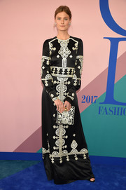 Constance Jablonski went the exotic route in a long-sleeve black Tory Burch gown with Eastern-inspired beading at the 2017 CFDA Fashion Awards.