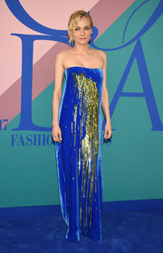 Diane Kruger oozed diva glamour in a strapless blue velvet Monse gown with green sequin detailing at the 2017 CFDA Fashion Awards.