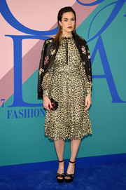 Mandy Moore softened her wild print with a floral leather jacket, also by Kate Spade.