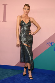 Martha Hunt sealed off her look with black ankle-wrap heels.