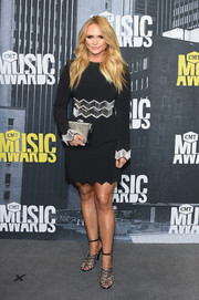 Miranda Lambert topped off her ensemble with a metallic silver clutch.