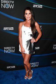 Lea Michele finished off her outfit with white ankle-strap sandals by Stuart Weitzman.