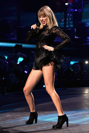 Taylor Swift was all legs in an embellished black Atelier Versace bodysuit with a fringed skirt while performing at the 2017 DIRECTV NOW Super Saturday Night concert.