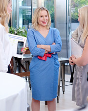 Kristen Bell was laid-back yet chic in a blue wrap dress styled with a knotted red belt at the #DrinkGoodDoGood campaign launch.