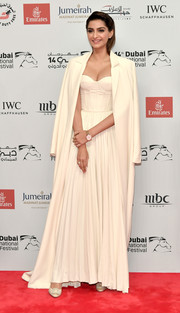 Sonam Kapoor topped off her gown with a matching wool coat.