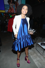 Yara Shahidi paired a white blazer with a blue ruffle-hem dress for the 2017 Essence Black Women in Music event.