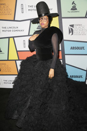 Erykah Badu got all decked up in a black Ashi Studio one-shoulder gown, boasting a fitted velvet bodice and a voluminous ruffle skirt, for the 2017 Essence Black Women in Music event.
