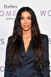 Kim Kardashian sported waist-length, center-parted hair with just a hint of wave when she attended the 2017 Forbes Women's Summit.