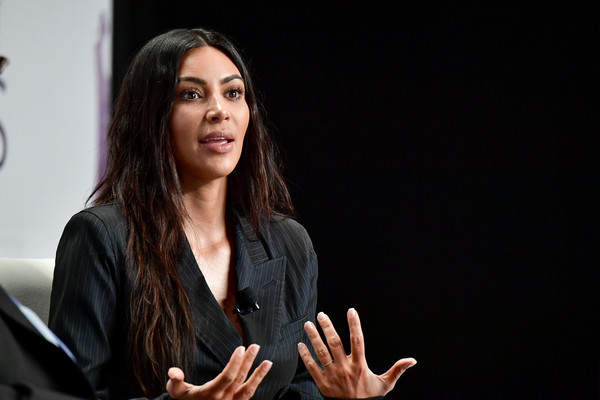 More Pics of Kim Kardashian Pantsuit (3 of 15) - Suits Lookbook - StyleBistro [gesture,hand,sign language,long hair,photography,conversation,public speaking,businessperson,kim kardashian,new york city,spring studios,forbes womens summit]