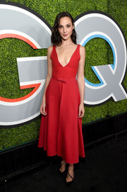 Gal Gadot made an alluring choice with this plunging red fit-and-flare dress by Dior for the 2017 GQ Men of the Year party.