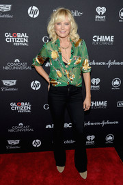 Malin Akerman flashed her black bra in a low-cut, semi-sheer print blouse by Alice + Olivia at the 2017 Global Citizen Festival.