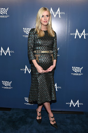 Nicky Hilton finished off her look with a pair of triple-bow pumps by Rene Caovilla.